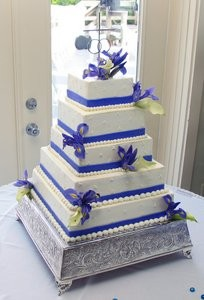 Many tiered square wedding cake.