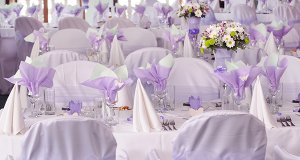 Wedding venue with purple tables decoration.