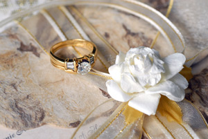 Wedding ring and flowers.