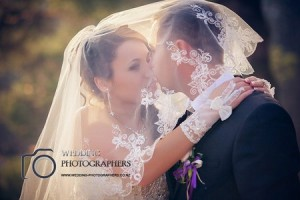 Kiss under the wedding veil.