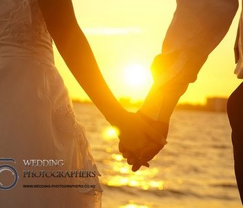 Holding hands at sunset.