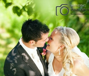 Wedding couple kiss in the park.