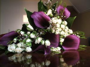 A wedding posy of purple and white flowers.