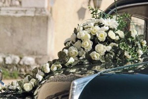White flowers decorating the wedding car.