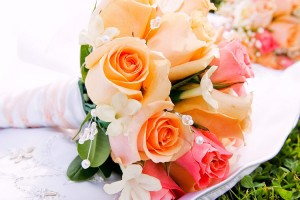 Colourful wedding bouquet displayed on a white cloth.