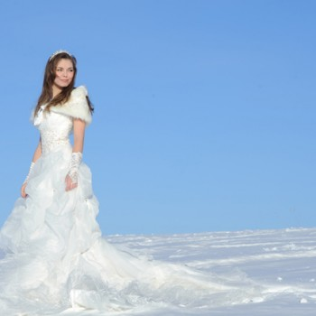 In the New Zealand mountains, winter wedding bridal portrait.