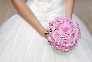 Bride holding bridal bouquet.
