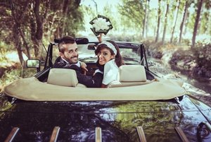 Just married couple in an old car.