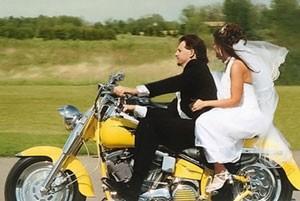 Just married leaving on motorbike.