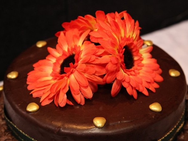 Flower decoration on a chocolate cake.