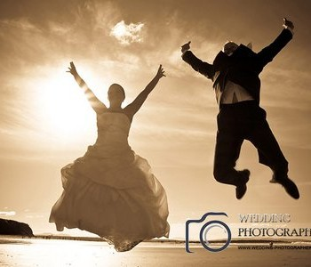 Jump for joy, sunset wedding photography.