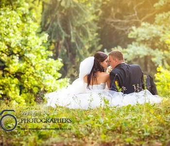 Romantic wedding couple in the park.