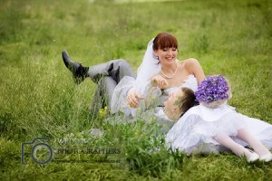 Bride and groom laughing together.
