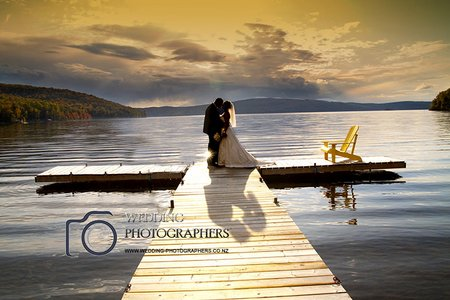 Bride and groom on jetty.