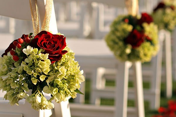 Floral display along the chairs at the wedding ceremony.