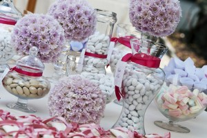 Floral decorations with sweet display at the wedding reception.