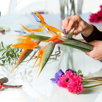 Flower arranging, putting it all together to make wedding bouquets.