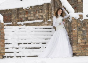 Bride in the snow before the wedding ceremony.