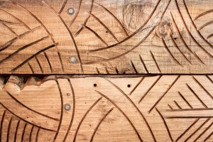maori carved craft wooden texture pattern background photo